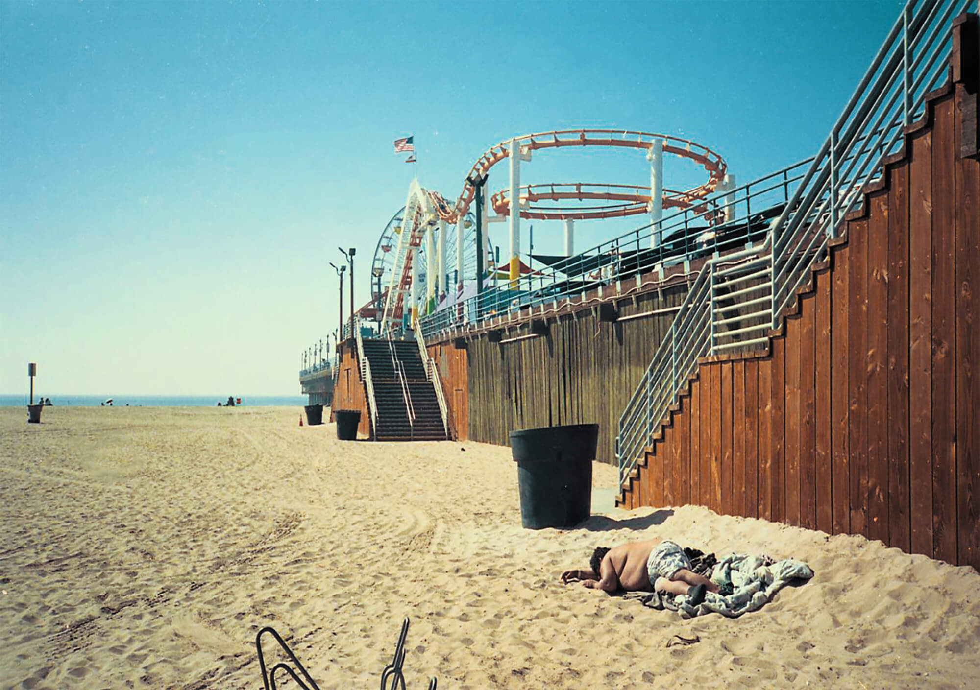 dan Morgan I is just somebody else man laying on golden beach in America the south west collective of photography ltd