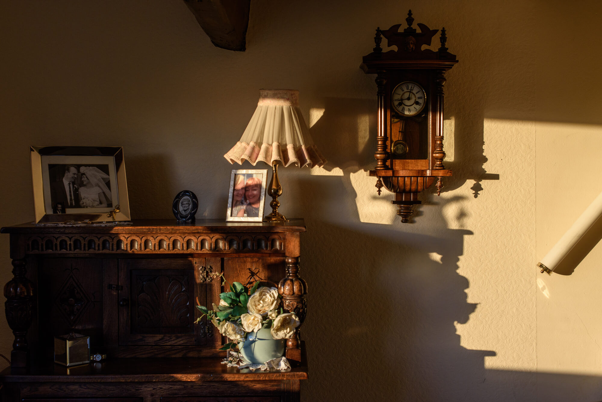 Alice Dempsey goodnight god bless sunlight on a white wall in a house the south west collective of photography ltd