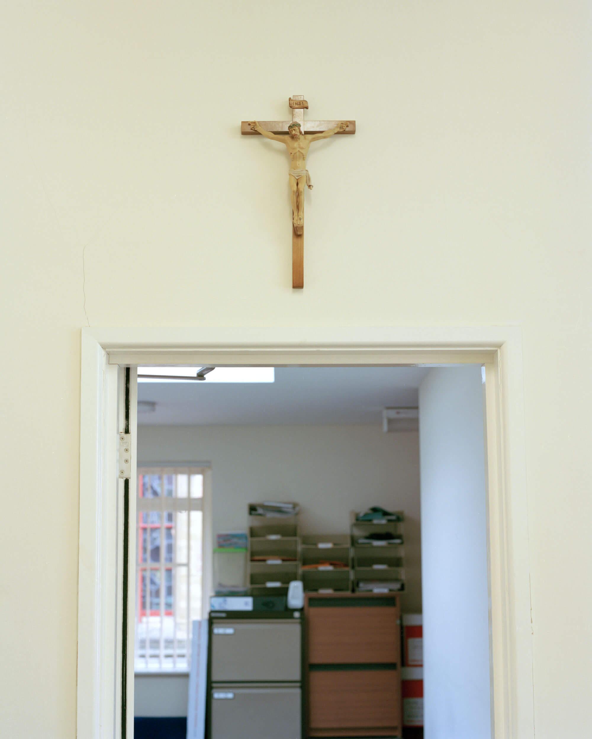cross over door in the Catholic Church