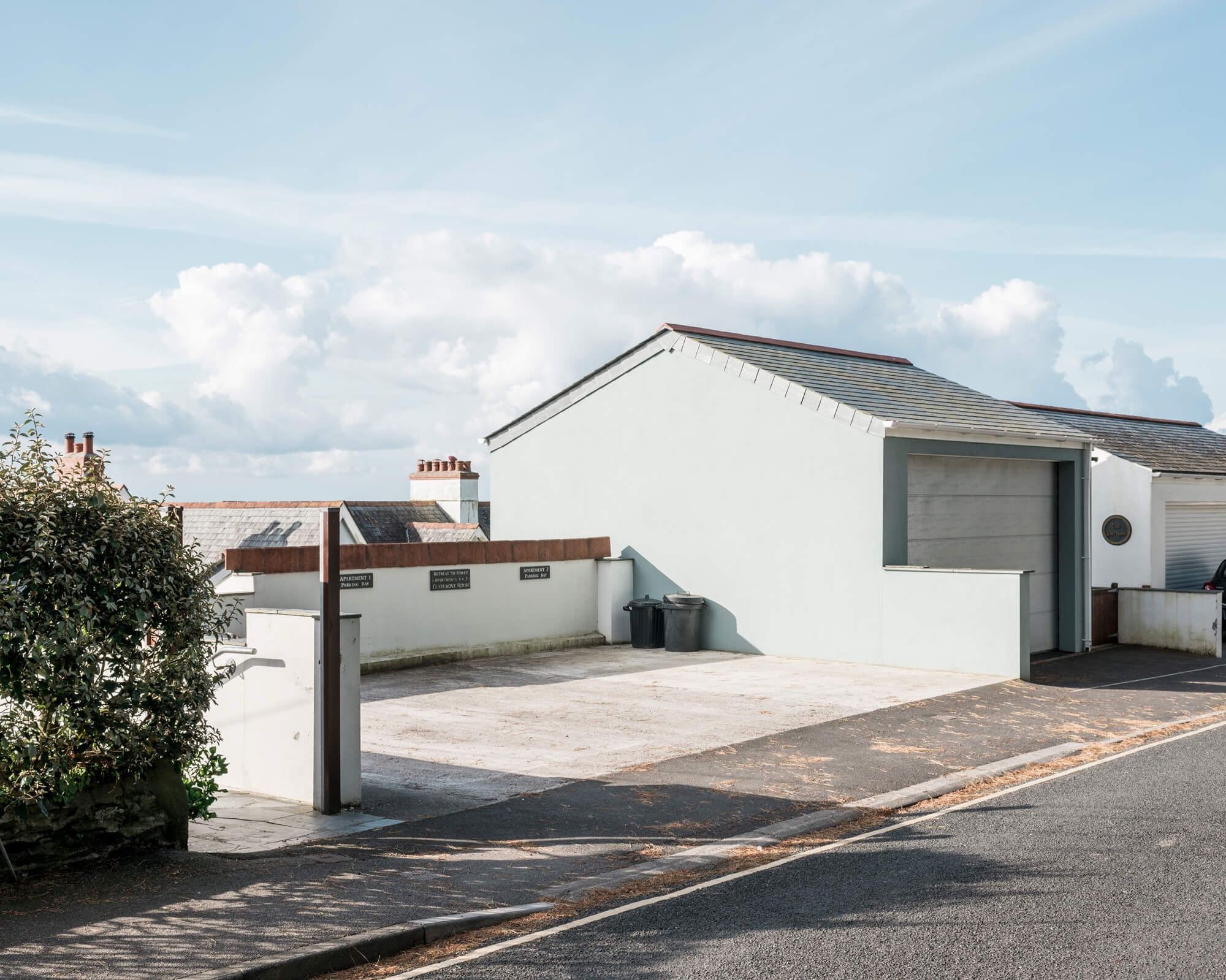 rob hardy house with garage with blue skied background in Cornwall