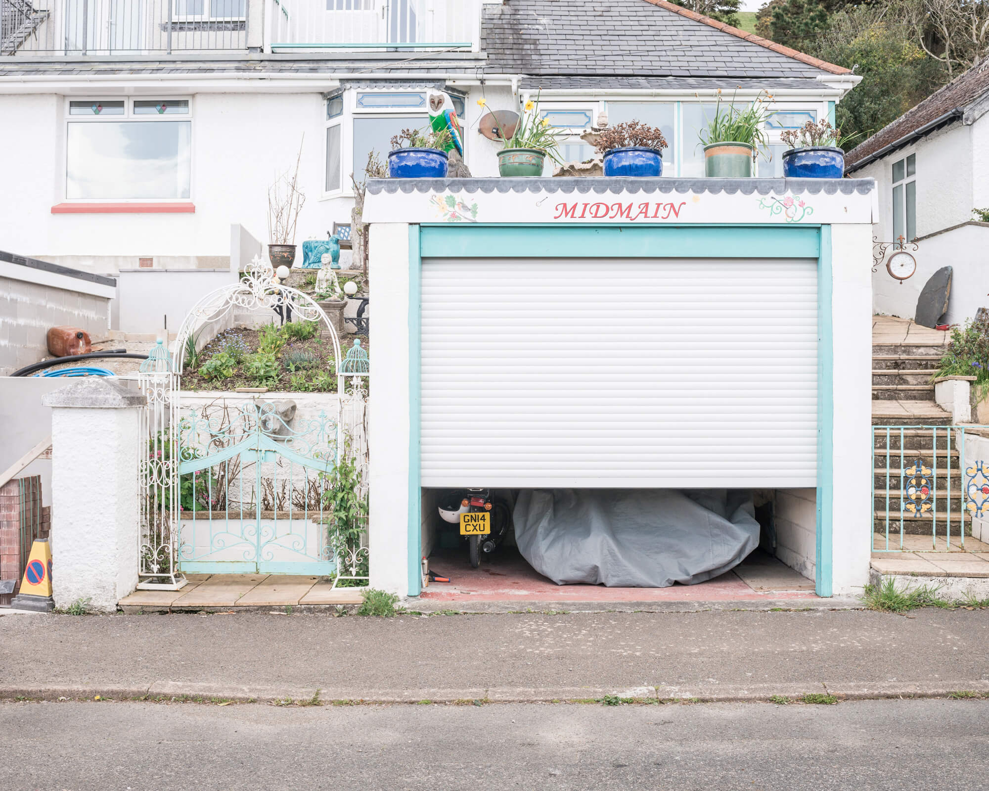 white garaged house in Cornwall with blue paint