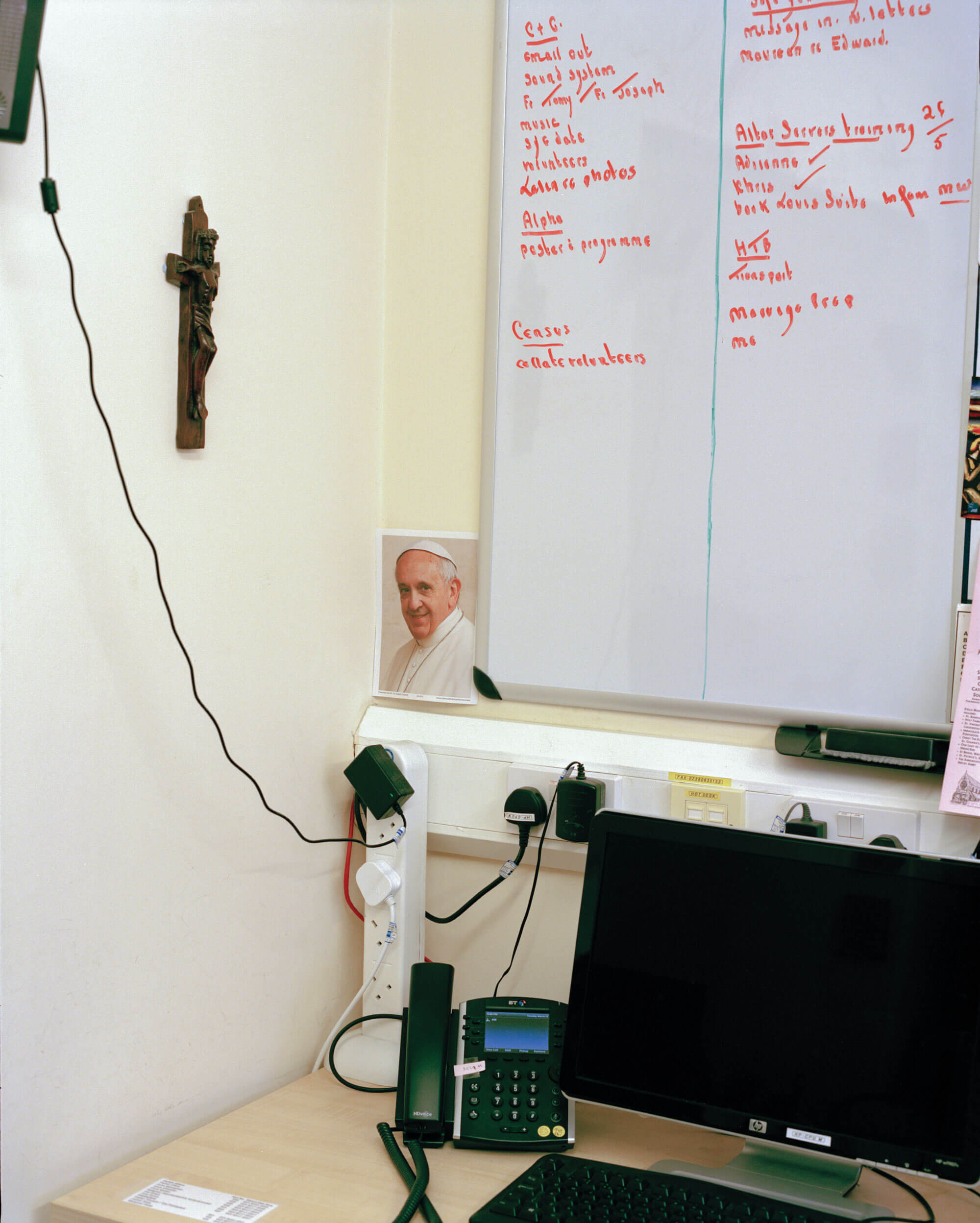 a picture of the pope sat against a whiteboard in a Catholic Church by matt Scott