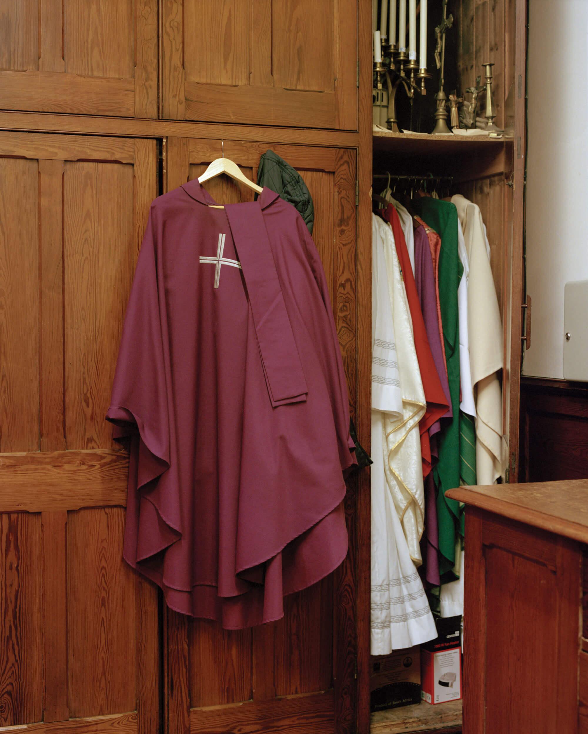 catholic robes in the church by matt Scott against wardrobe
