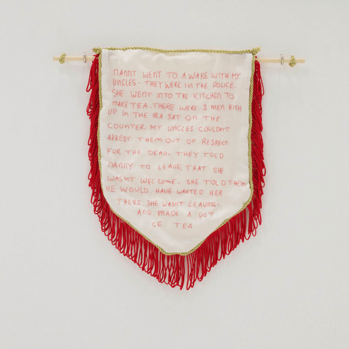 red and white banner on white wall Zoe Harrison the south west collective