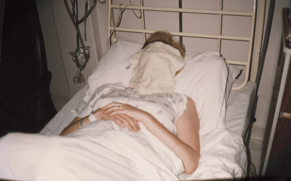 women laying in bed with sheets over her face in hospital Zoe Harrison bloodline of mine