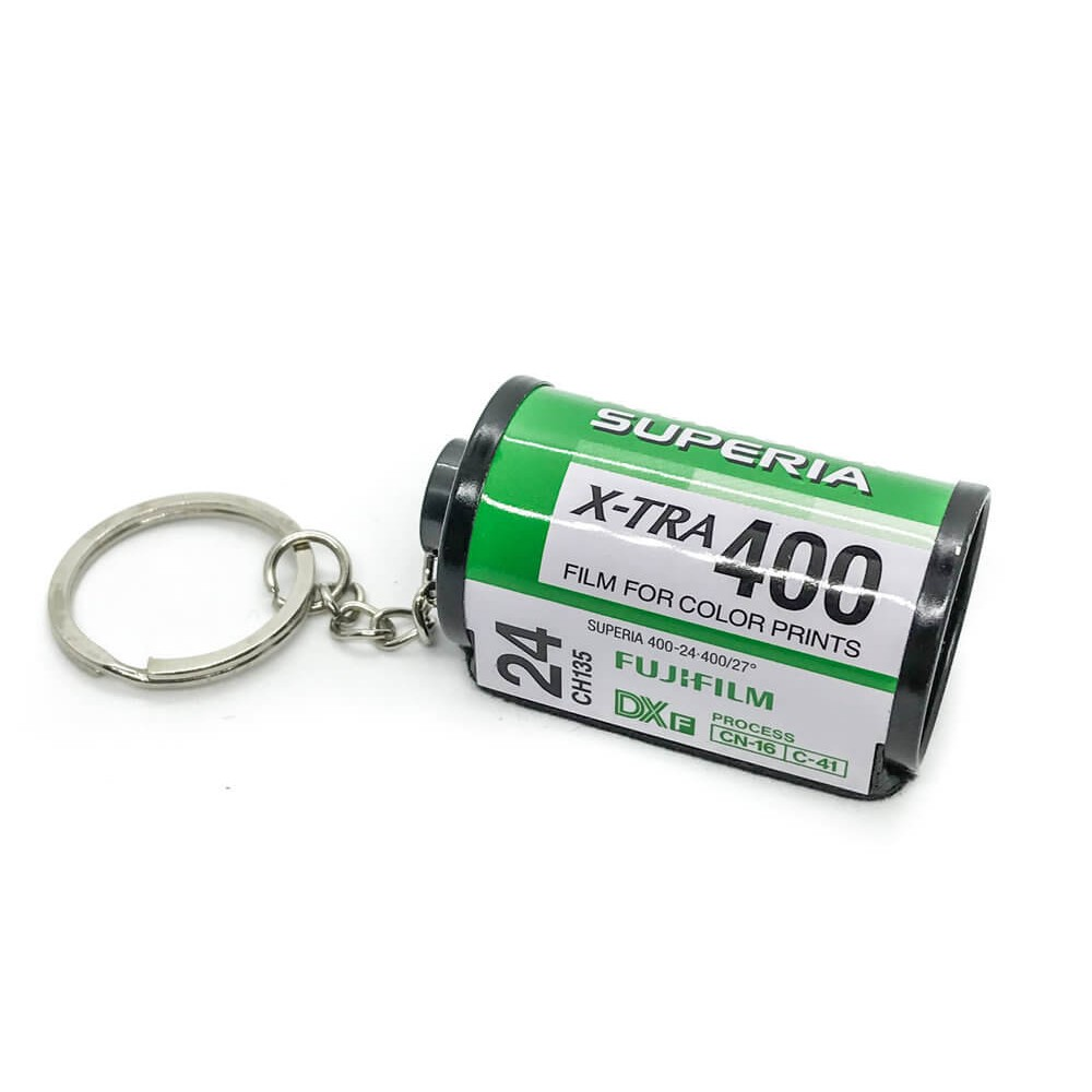 35mm green film keychain on white background fujifilm