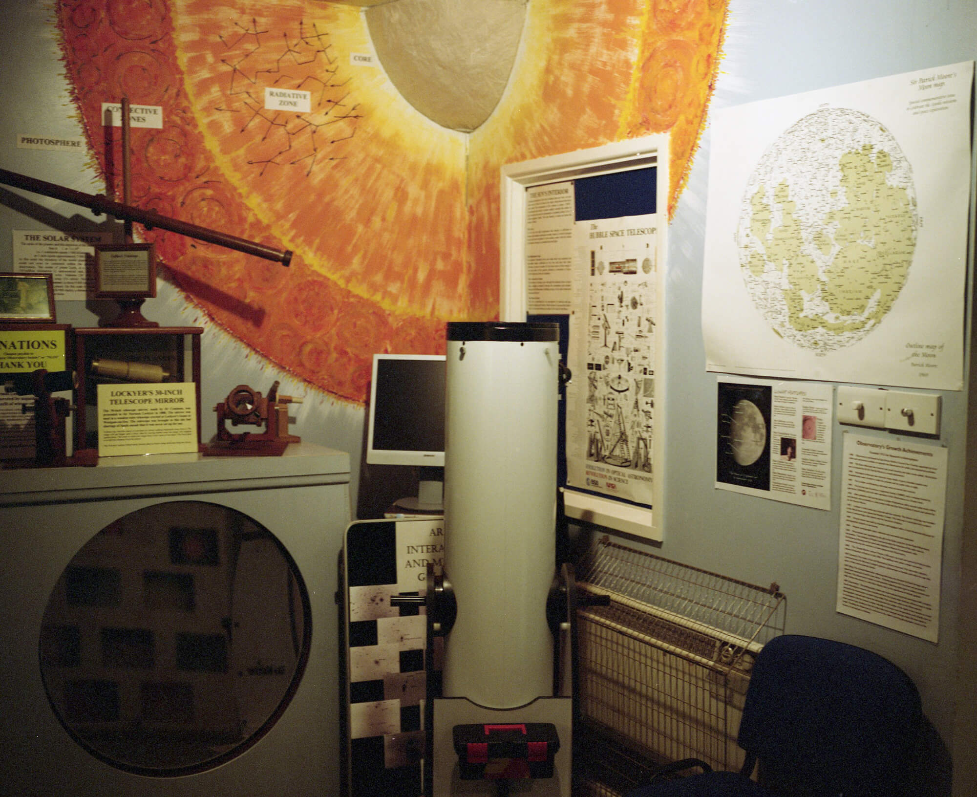 inside of observatory with maps of space and computers
