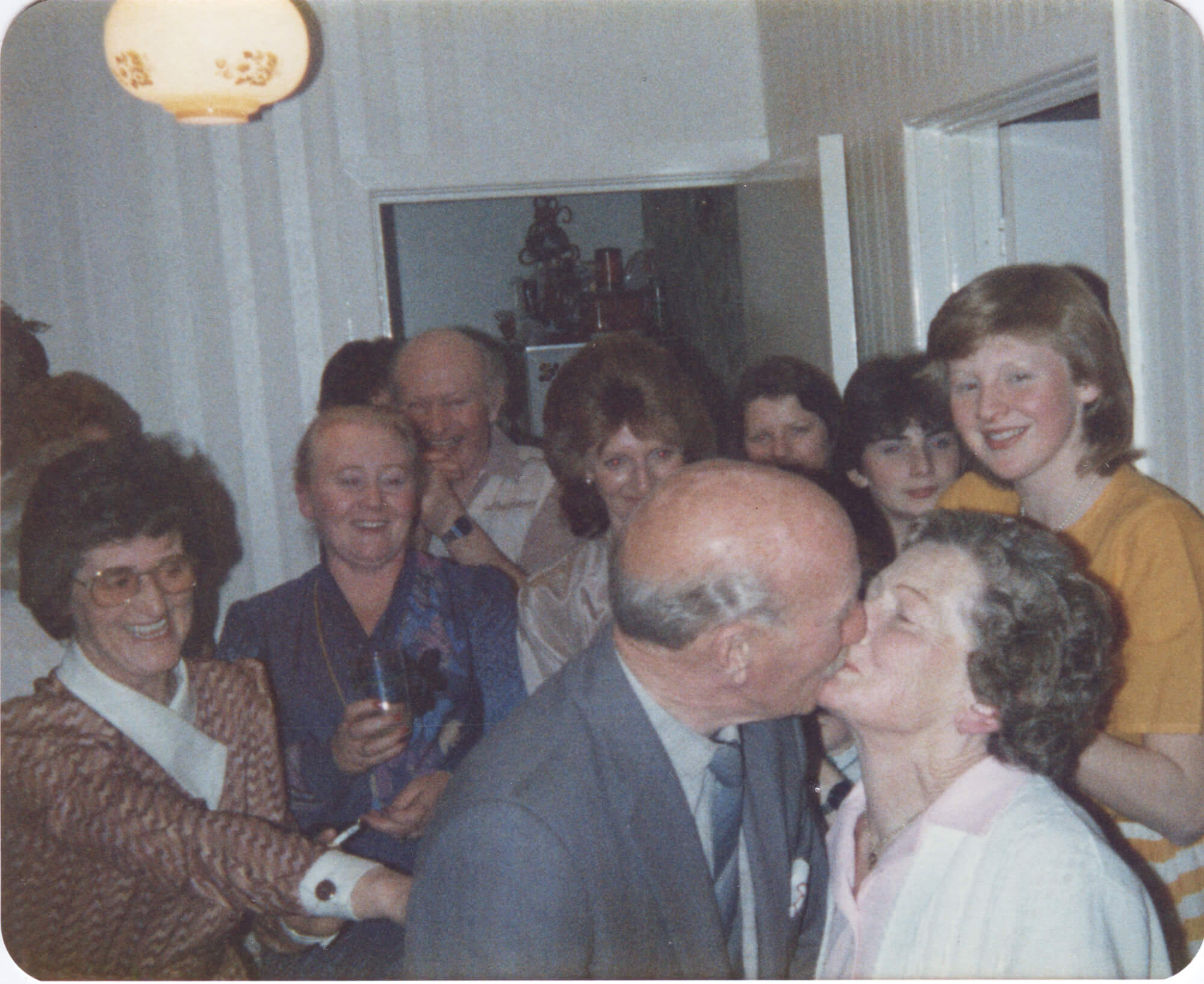 grandad kissing his wife at party on the south west collective of photography