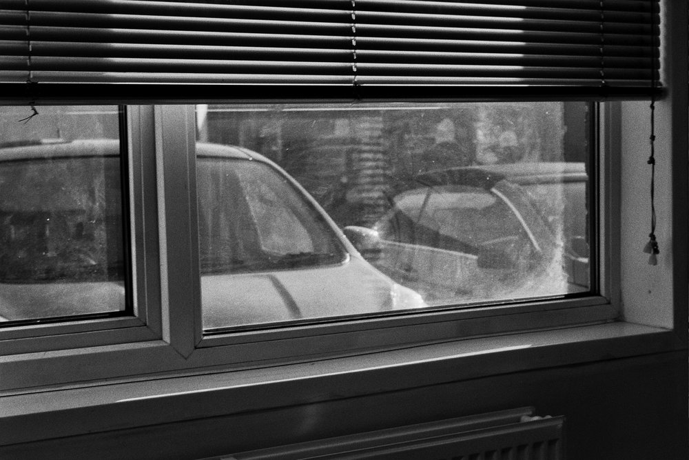 Black and white photo looking out of a window