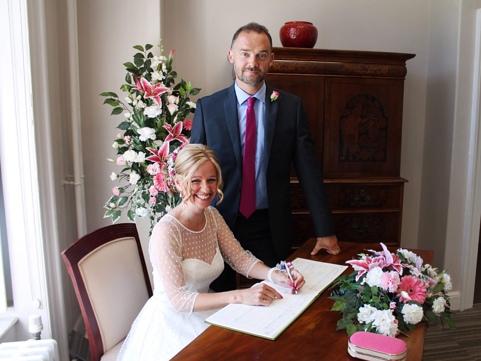 Couple signing wedding register in church