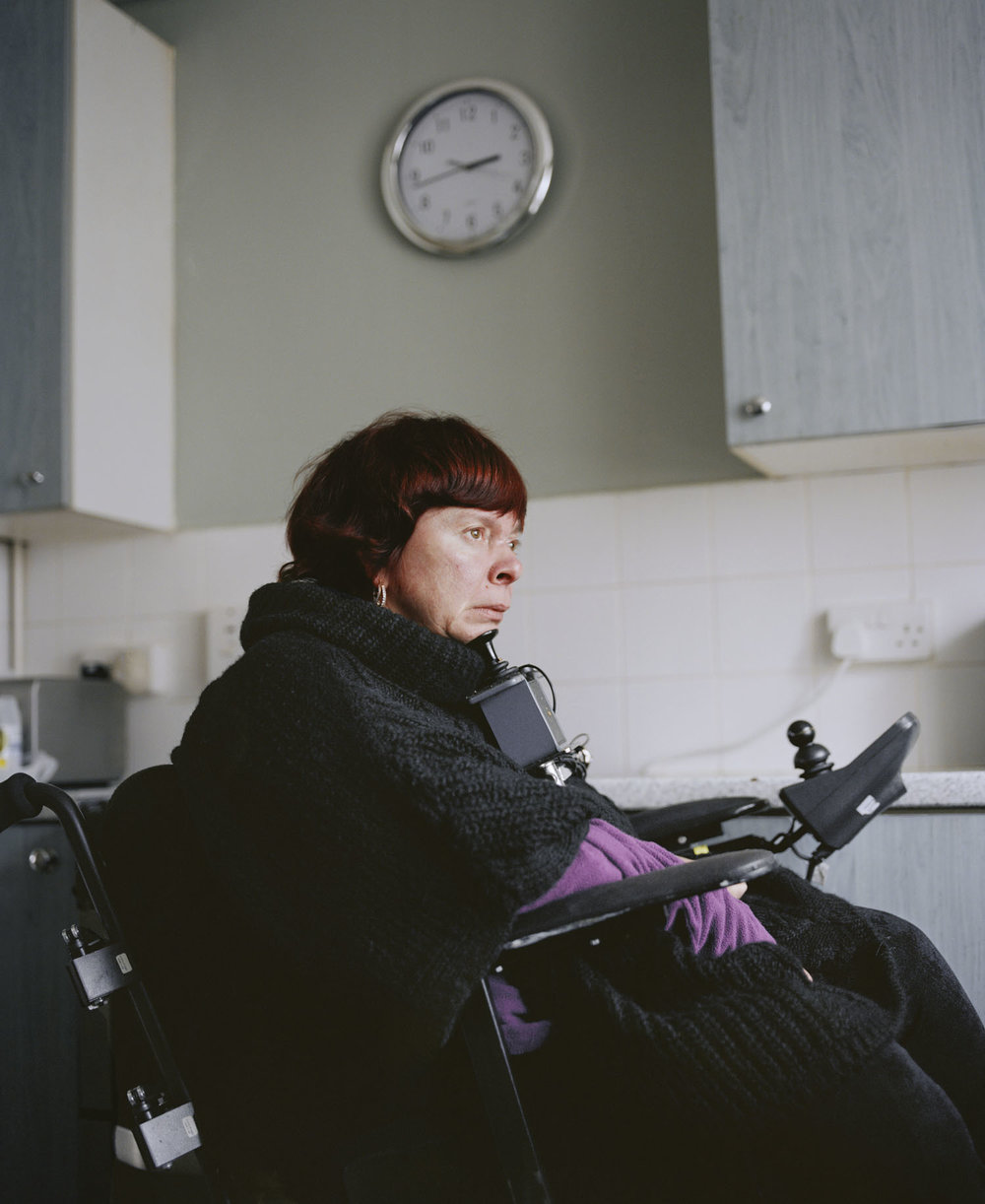 Sandra Mickiewicz Happy Club disabled women sat in wheelchair in her home in jaywick