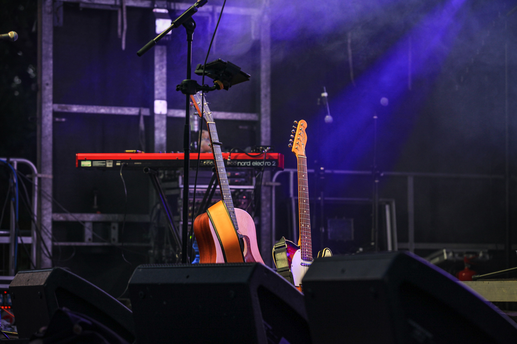 instruments and guitar on stage at Dartmouth music festival