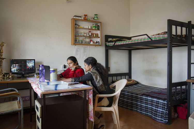 Charlotte Colenutt Soul Mate ladies working in their bedroom in India