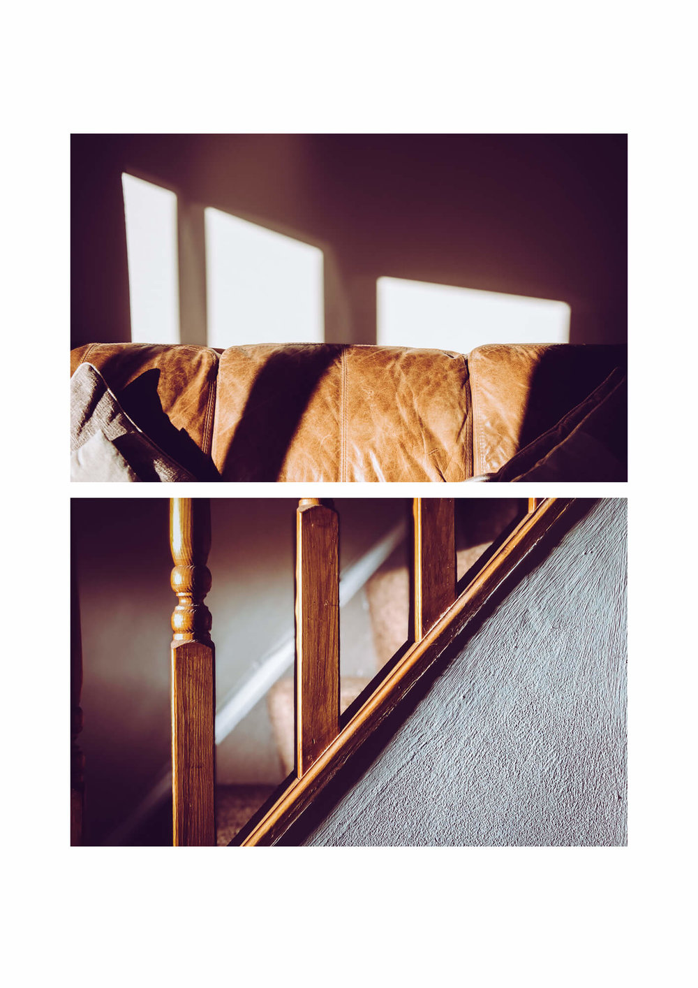 sunlight shining through a window onto the brown banister of a staircase