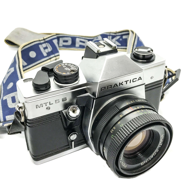 Praktica Mtl 5 B with 50mm lens on white background