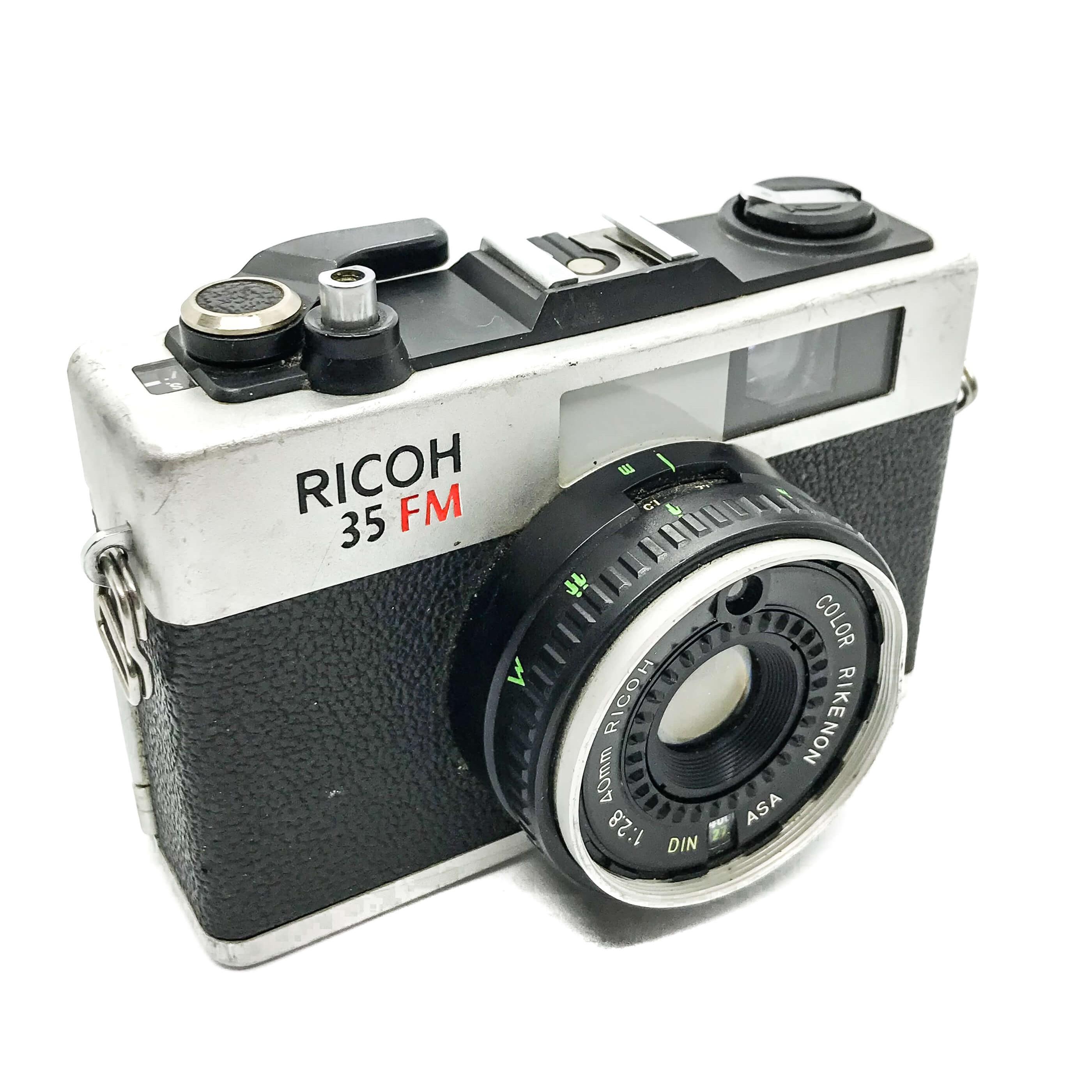 Richoh 35mm camera on white background