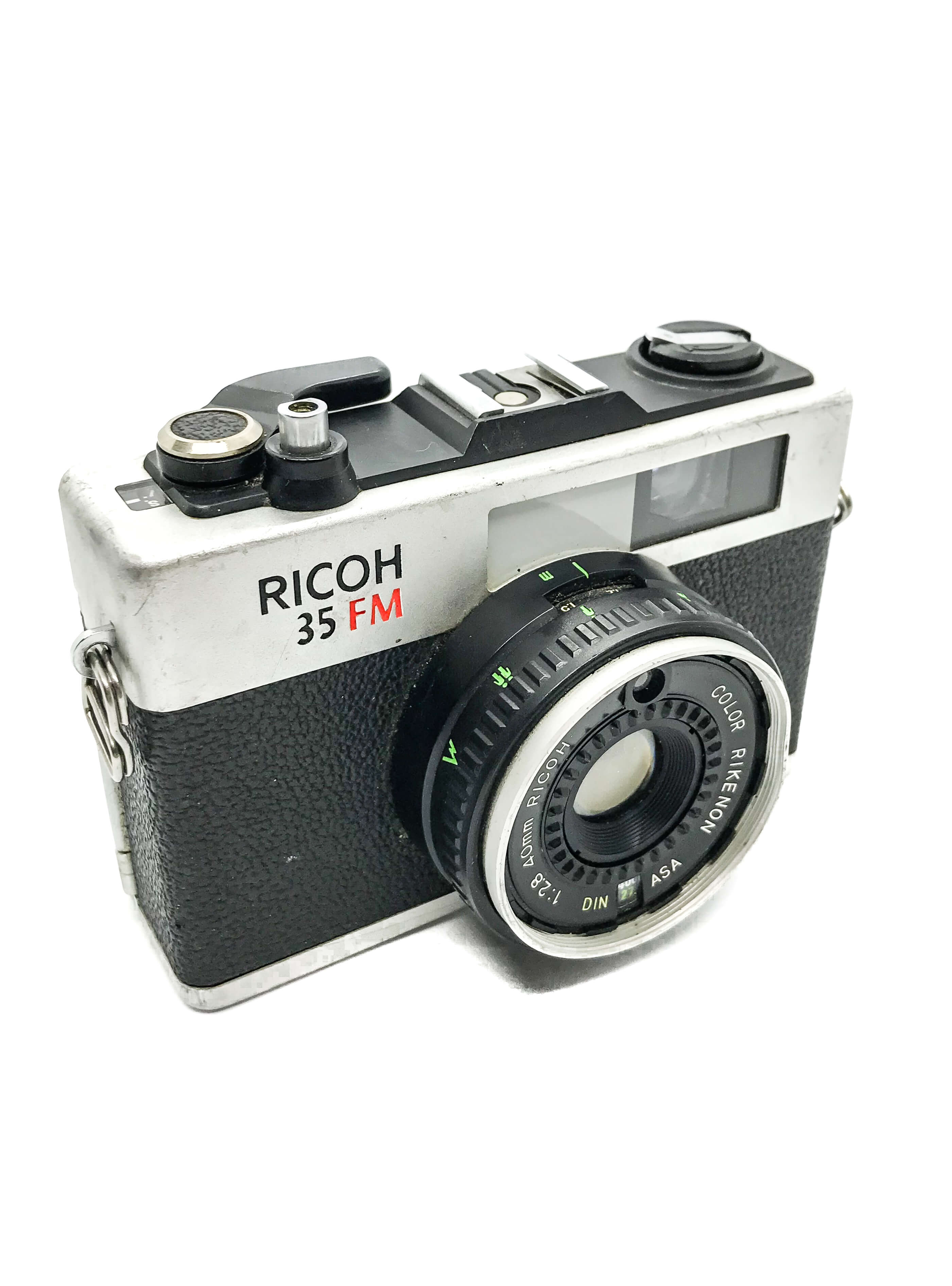 Richoh 35mm camera on white background