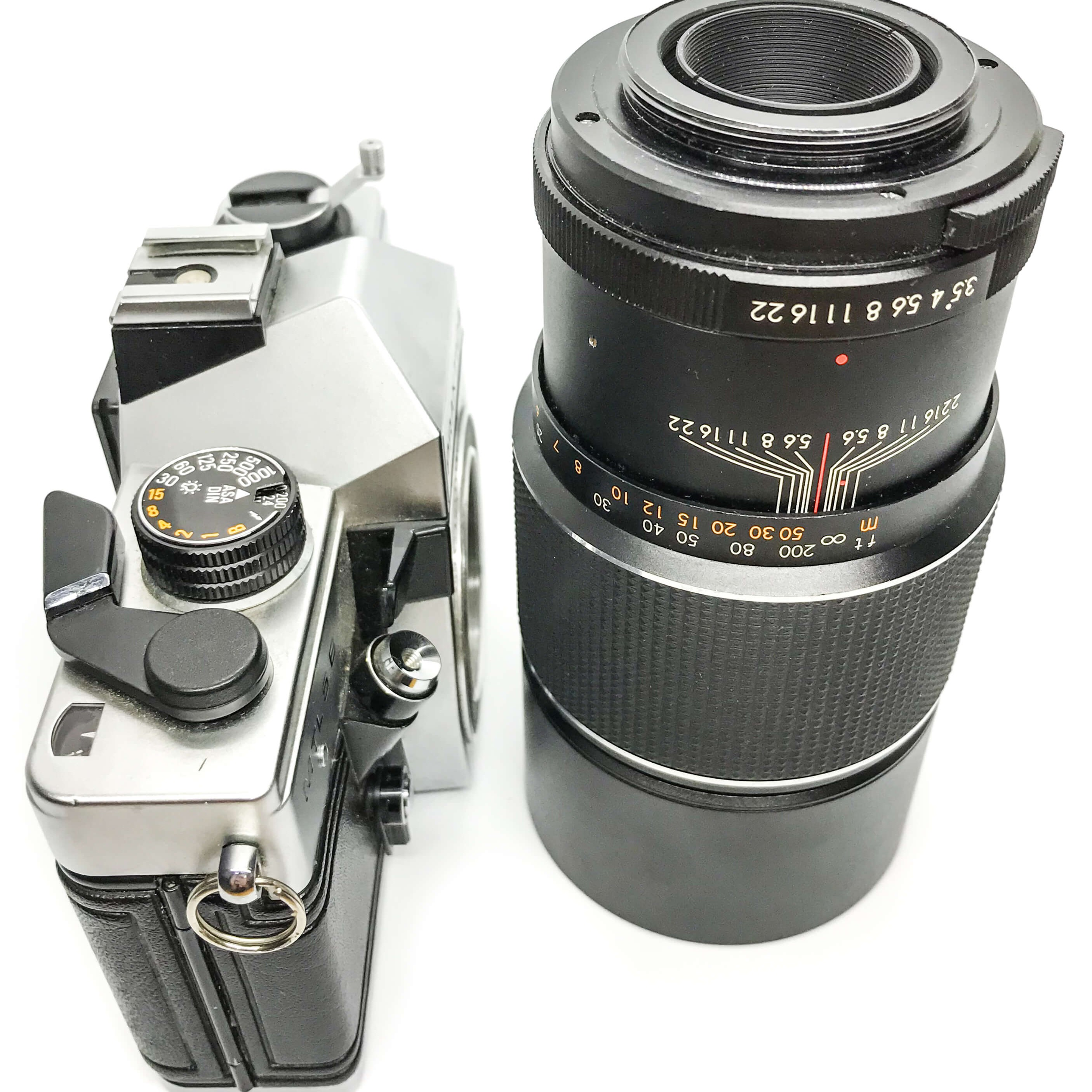 Praktica MTL5 B 35mm Film Camera and 200mm Lens on white background 35mm film camera vintage