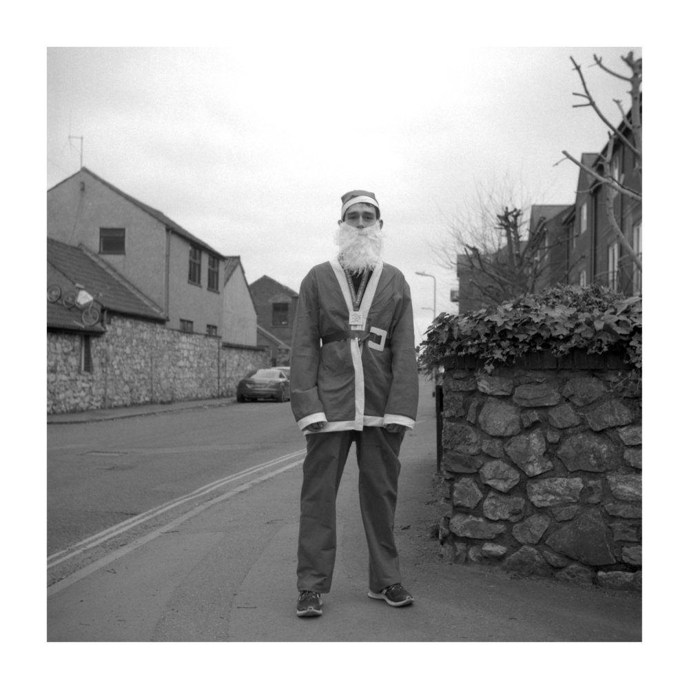 tavis amosford the project young man dressed as Santa