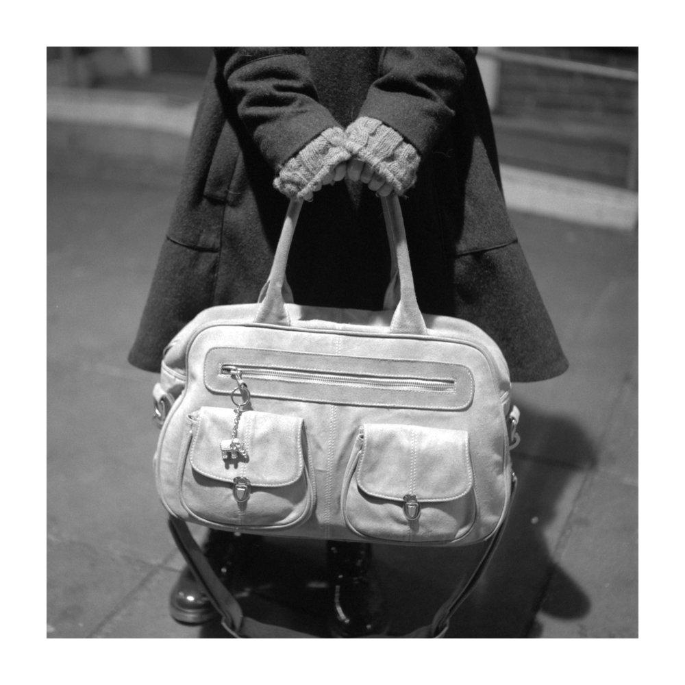 tavis amosford the project women holding handbag