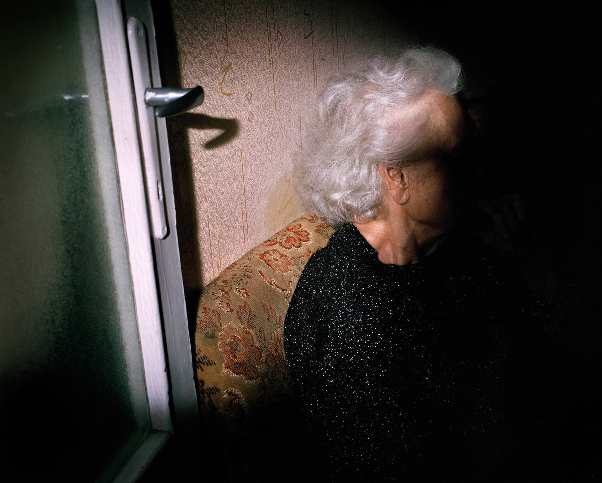 Piotr Karpinski the south west collective of photography elderly women with light on half of her face