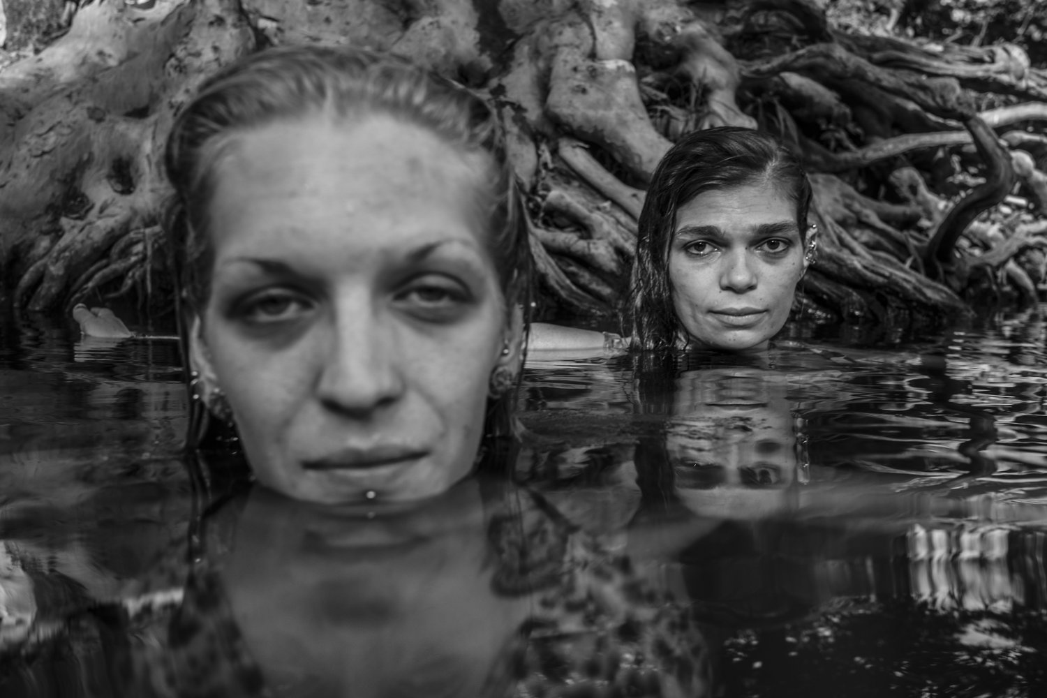 the south west collective Caleb stein two women swimming in river