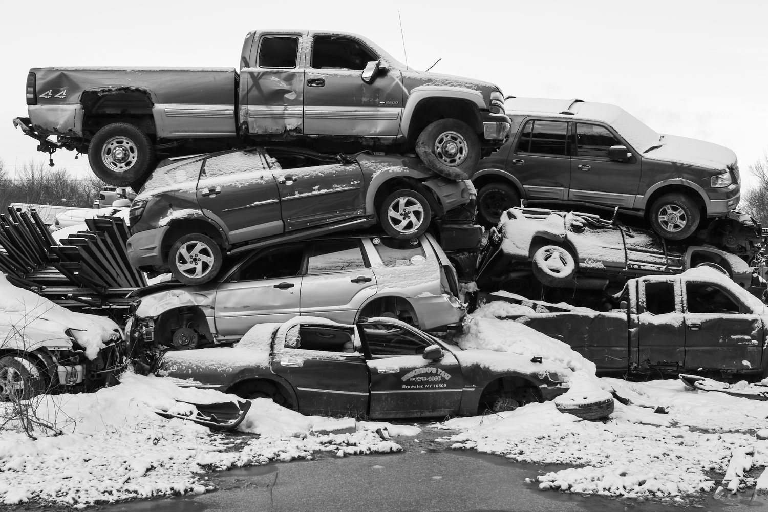 the south west collective Caleb stein junk yard and scarp cars in the snow