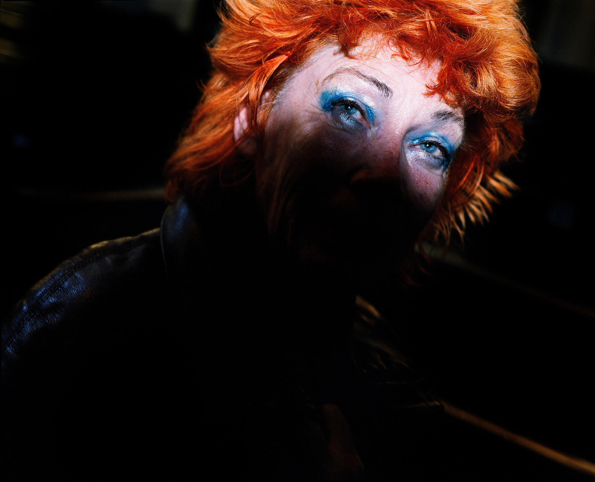 Piotr Karpinski the south west collective of photography ginger women with blue makeup in darkness