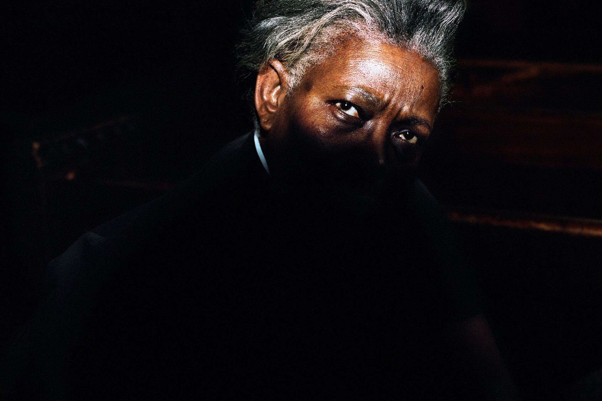 Piotr Karpinski the south west collective of photography black man with light on half of his face