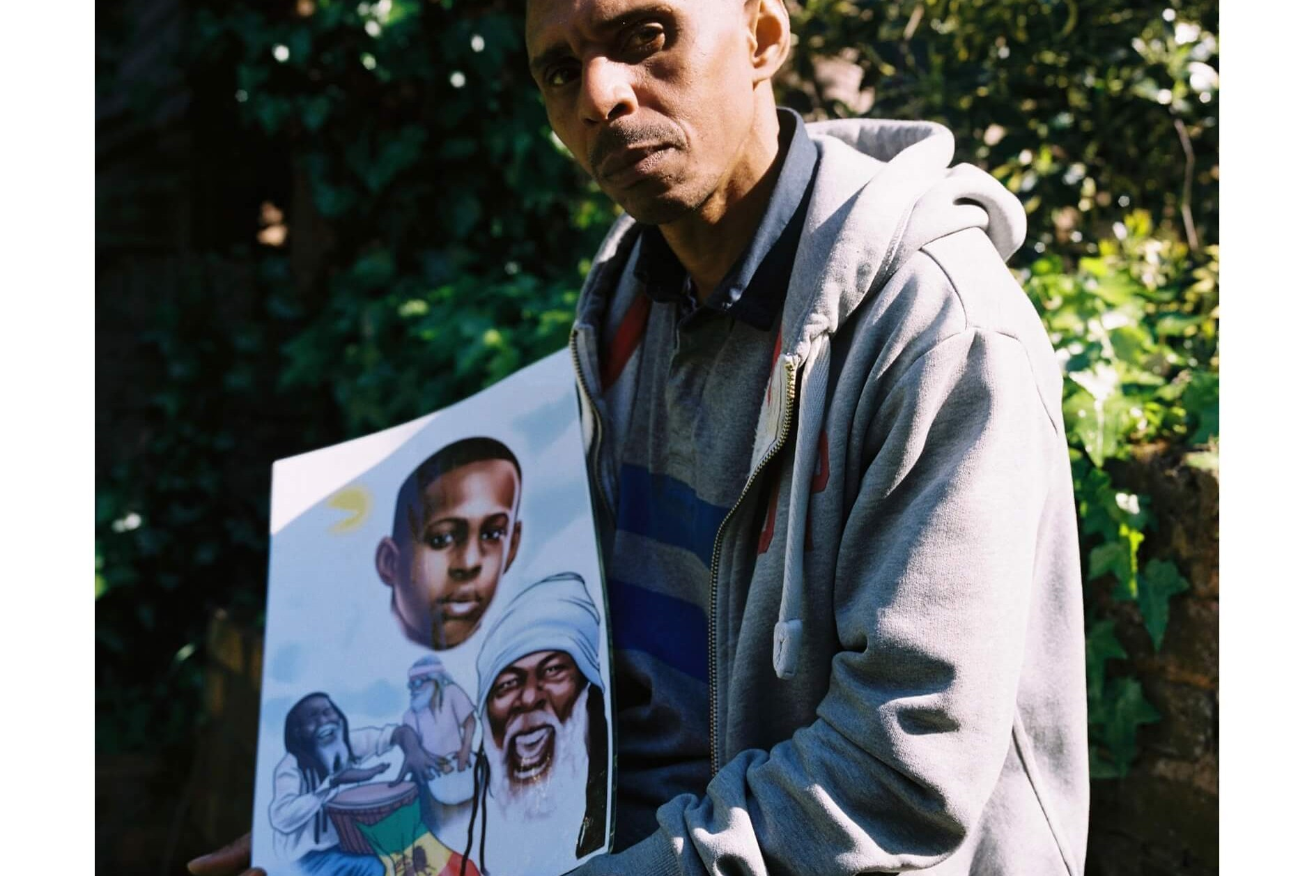 The South West Collective of photography Archie wells father holds photo of murdered son