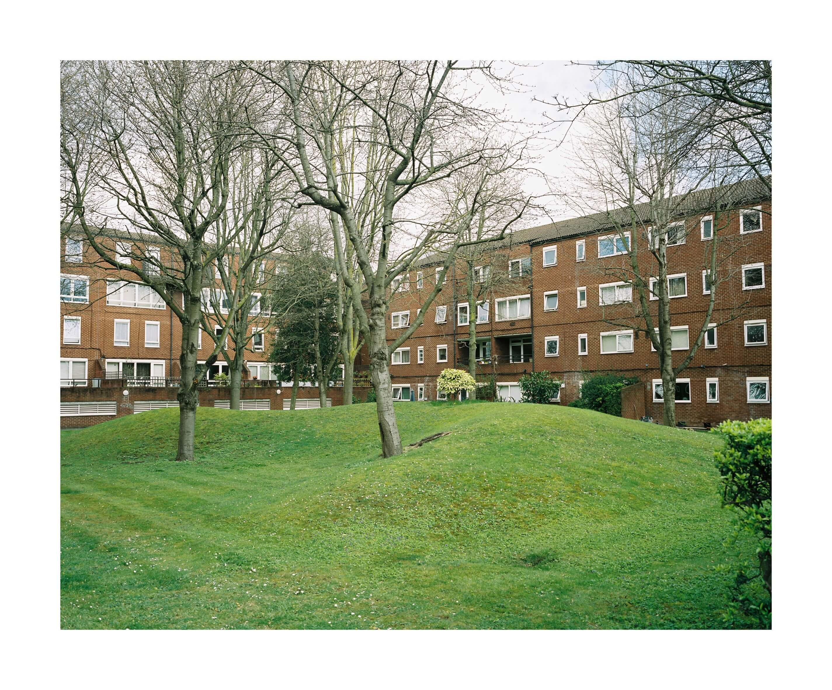 The South West Collective of photography Archie wells the scene of another stabbing in London, brick buildings and green grass
