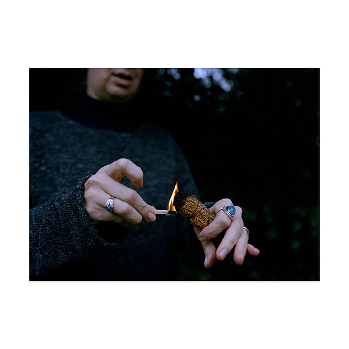Isobel Colnaghi the south west collective of photography picture of womens hands lighting fire