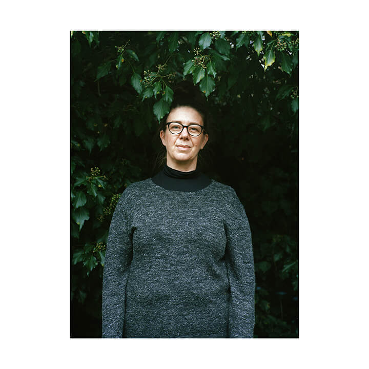 Isobel Colnaghi the south west collective of photography portrait of women against green background