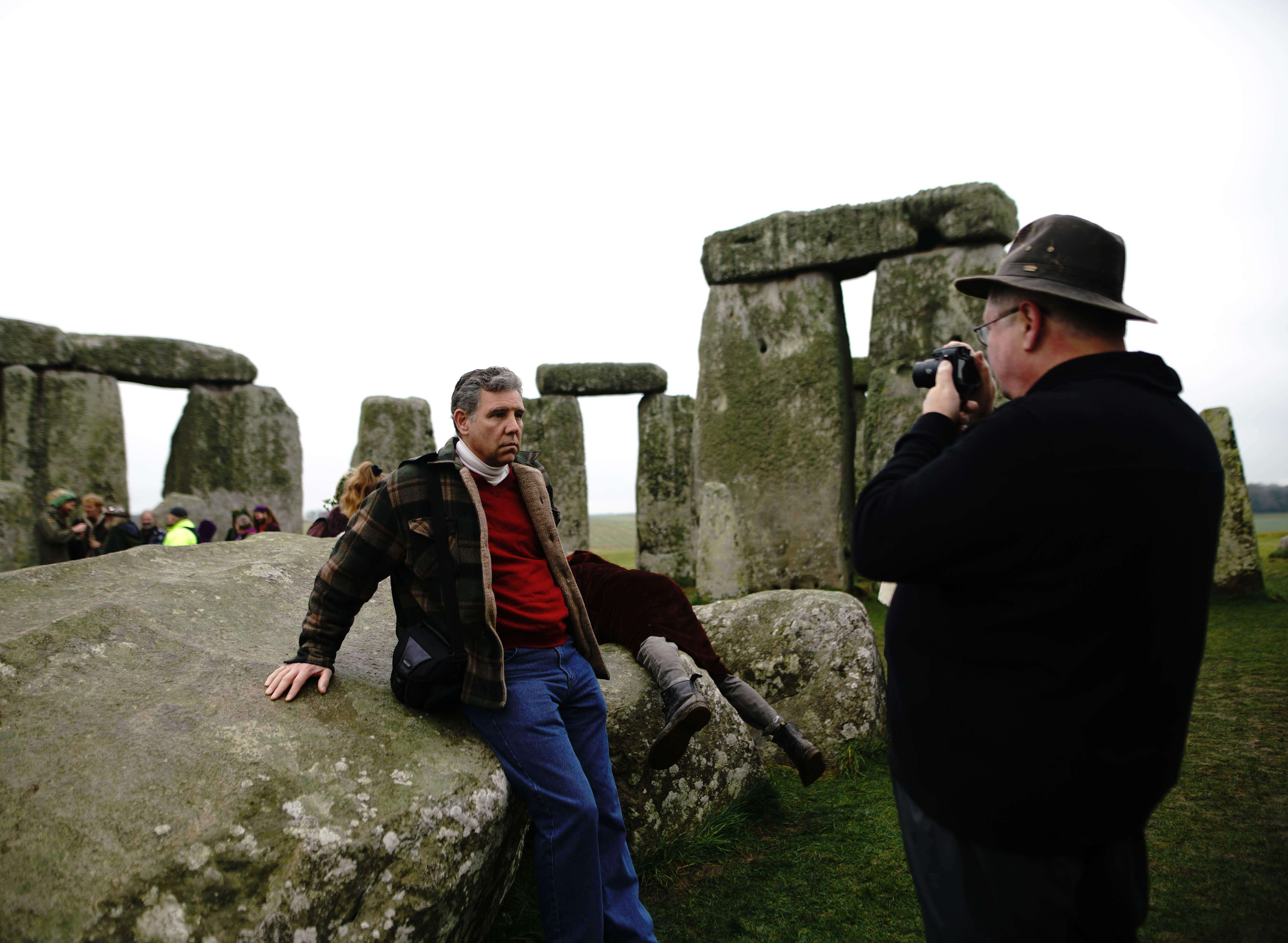 ana paganini stonehenge Summer and Winter Solstices the south west collective of photography man sitting on stonehenge