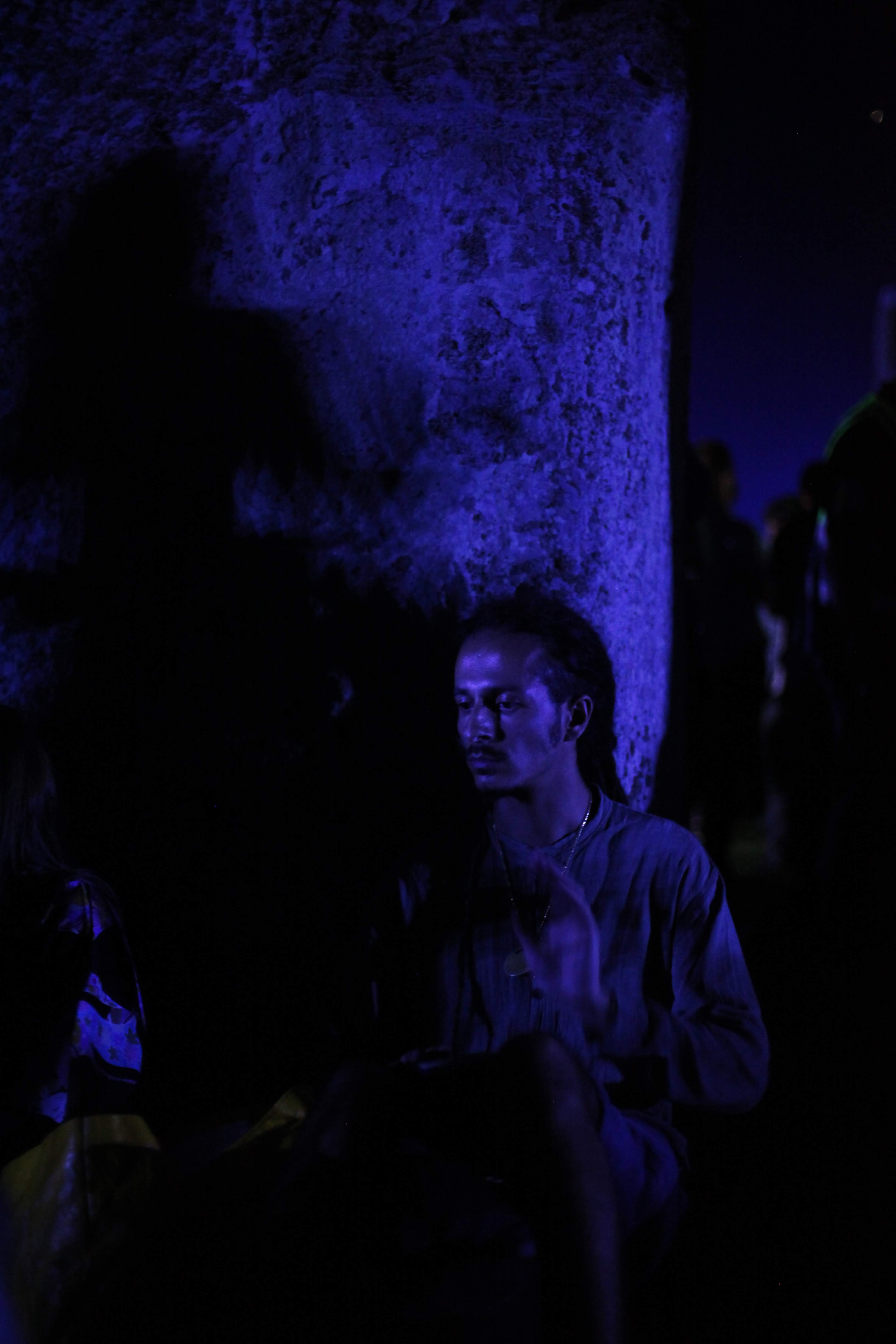 ana paganini stonehenge Summer and Winter Solstices the south west collective of photography man stood against tree in blue light