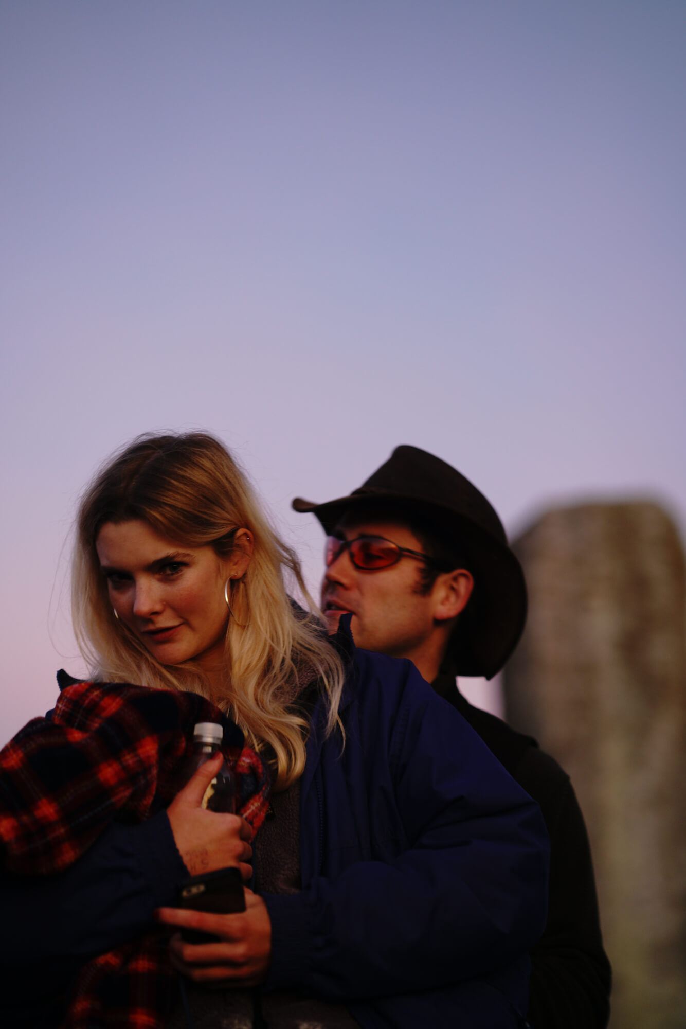 ana paganini stonehenge Summer and Winter Solstices the south west collective of photography couple pose for portrait at sunset