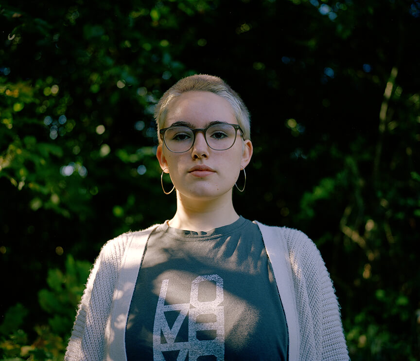 Portrait of girl with sunlight on her face Imogen Glanville the south west collective of photography