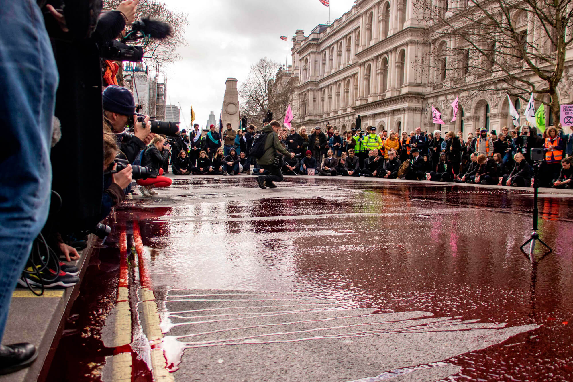 Miriam Hauertmann, Blood of our Children 1 extinction rebellion throwing fake blood on street the south west collective of photography
