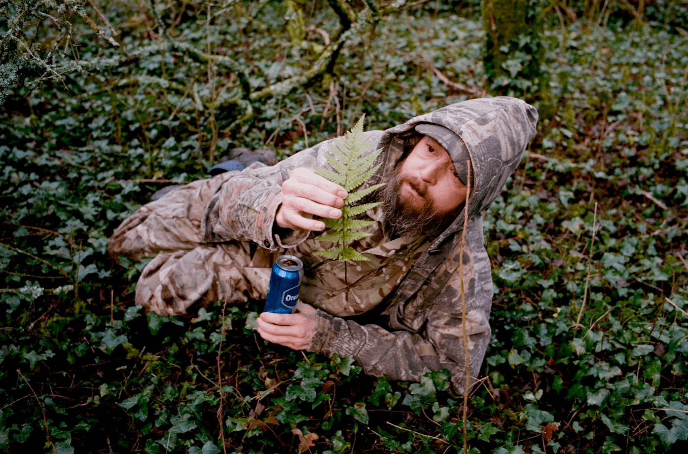 Dan Wood Pove The Great the south west collective of photography ltd man with beer laying in bush