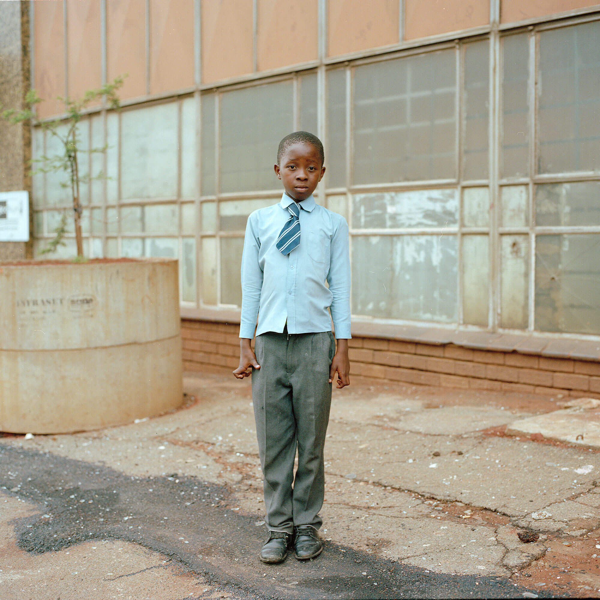 Claudio Rasano SOUTH AFRICA EVERYONE LIVE IN THE SAME PLACE LIKE BEFORE portrait of school boy