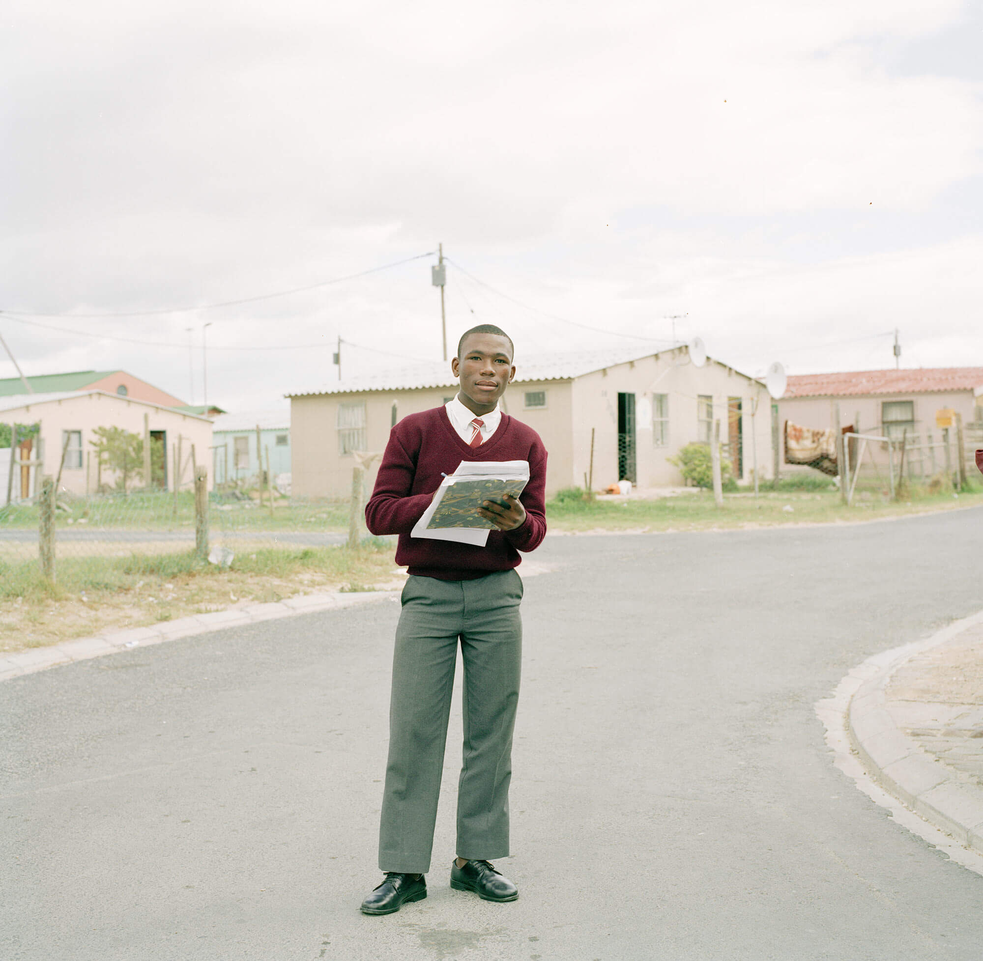 Claudio Rasano SOUTH AFRICA EVERYONE LIVE IN THE SAME PLACE LIKE BEFORE portrait of man in suit with clipboard