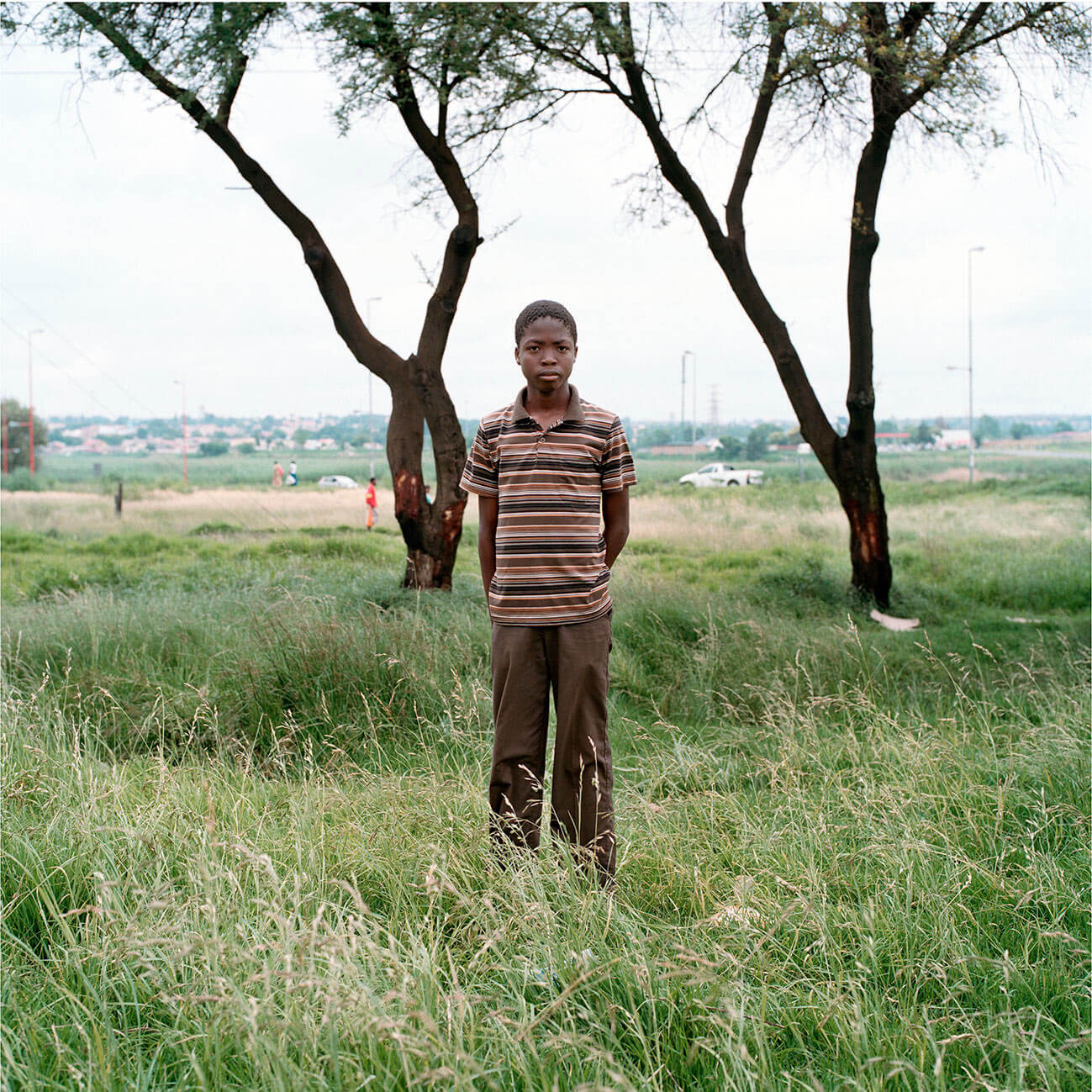 Claudio Rasano SOUTH AFRICA EVERYONE LIVE IN THE SAME PLACE LIKE BEFORE portrait of man stood in field
