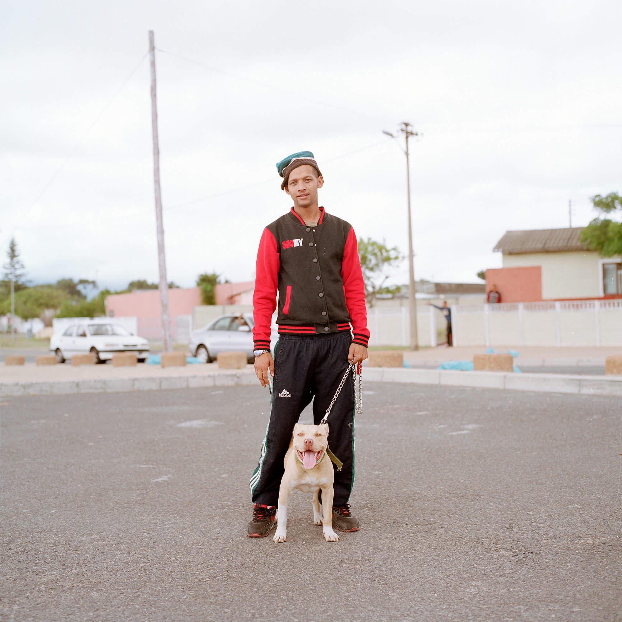Claudio Rasano SOUTH AFRICA EVERYONE LIVE IN THE SAME PLACE LIKE BEFORE portrait of man and his dog