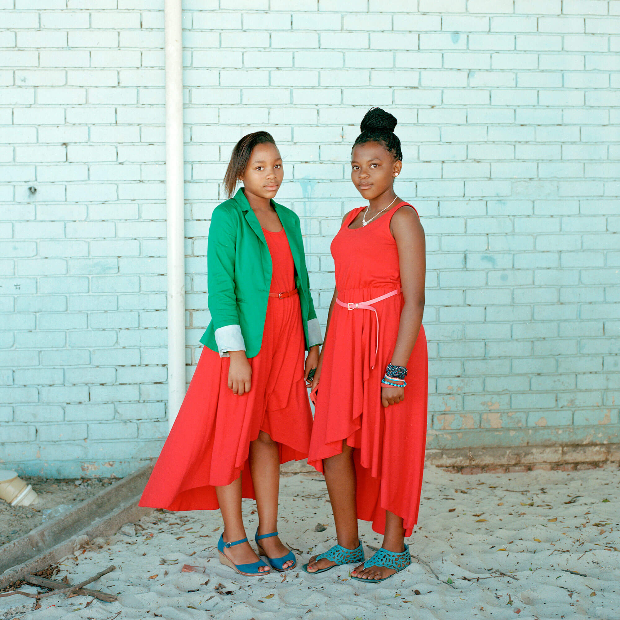 Claudio Rasano SOUTH AFRICA EVERYONE LIVE IN THE SAME PLACE LIKE BEFORE portrait of two women in red dresses