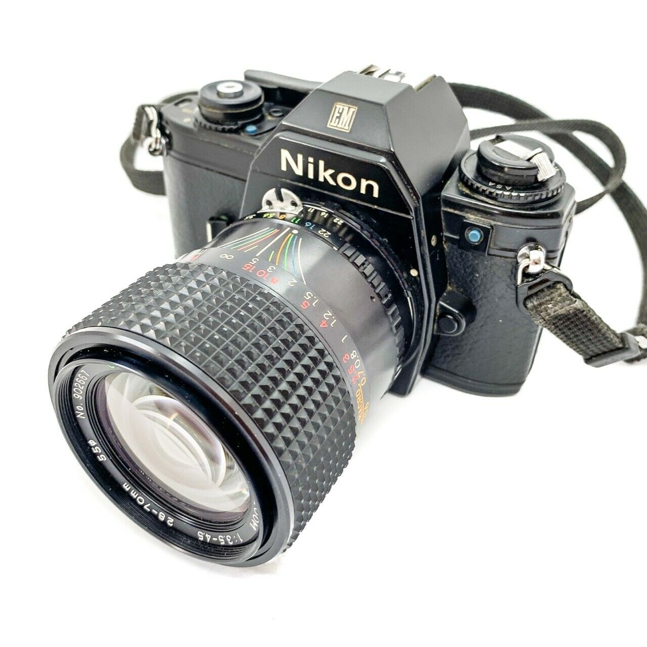 Nikon em 35mm camera on white background
