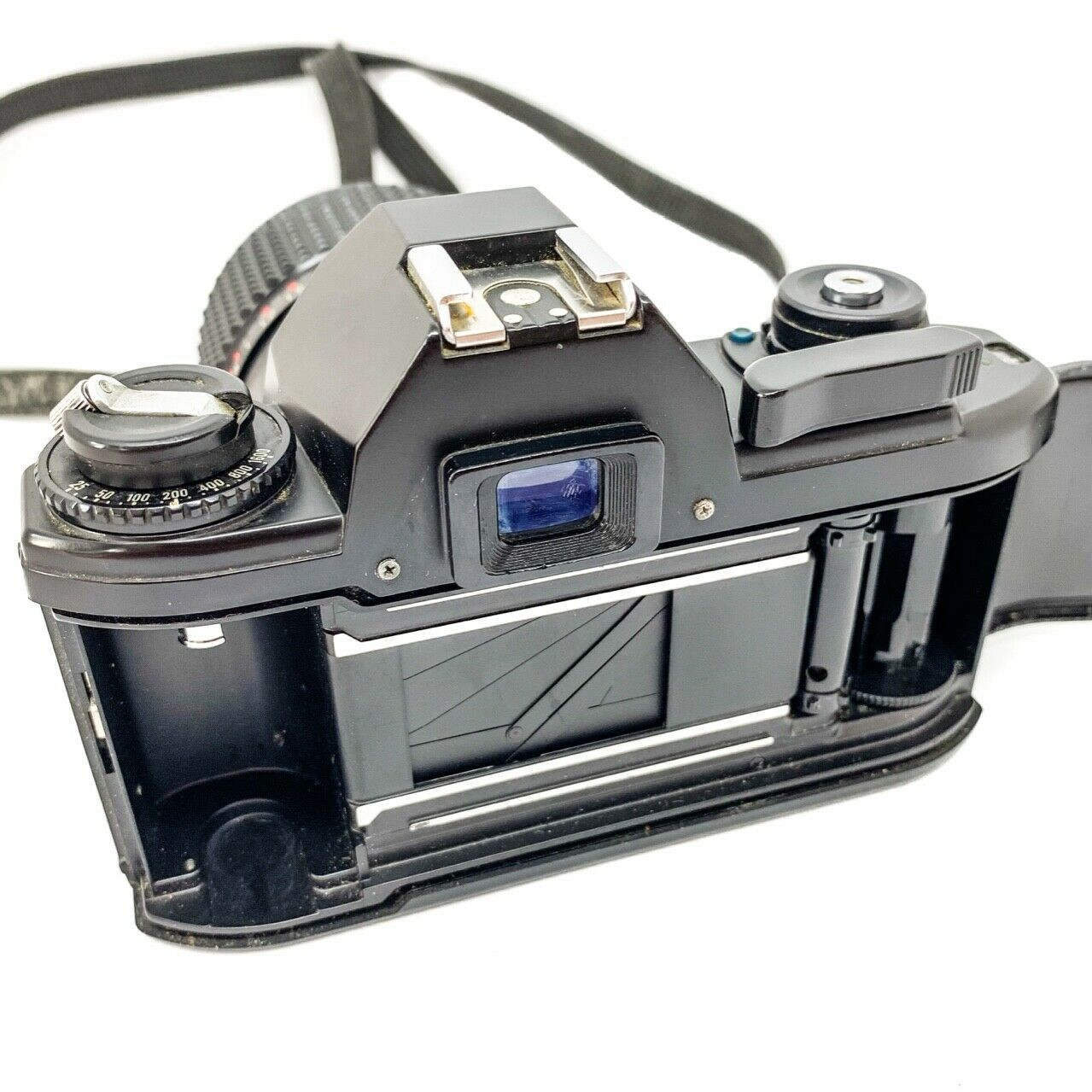 Nikon em 35mm camera on white background