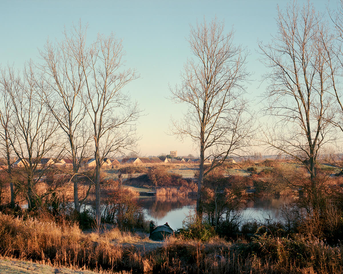 bearing fruit Simon Martin landscape on sunny day with lake the south west collective of photography