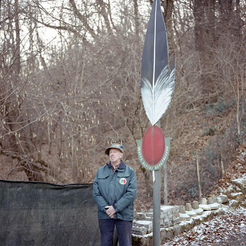 Giulia Simonotti SIAMO TUTTI ALPINI the south west collective of photography portrait of man stood under giant feather