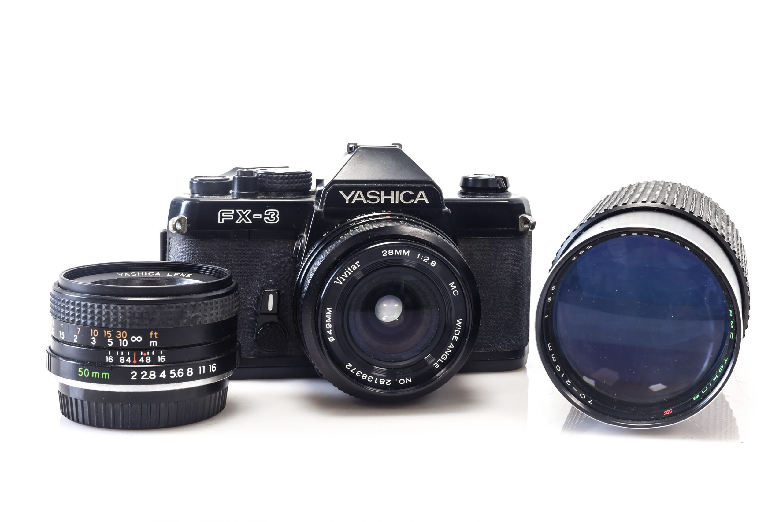 Lovely Yashica FX-3 35mm Film Camera with 28mm Lens + 50mm Lens + 70 - 210mm Lens