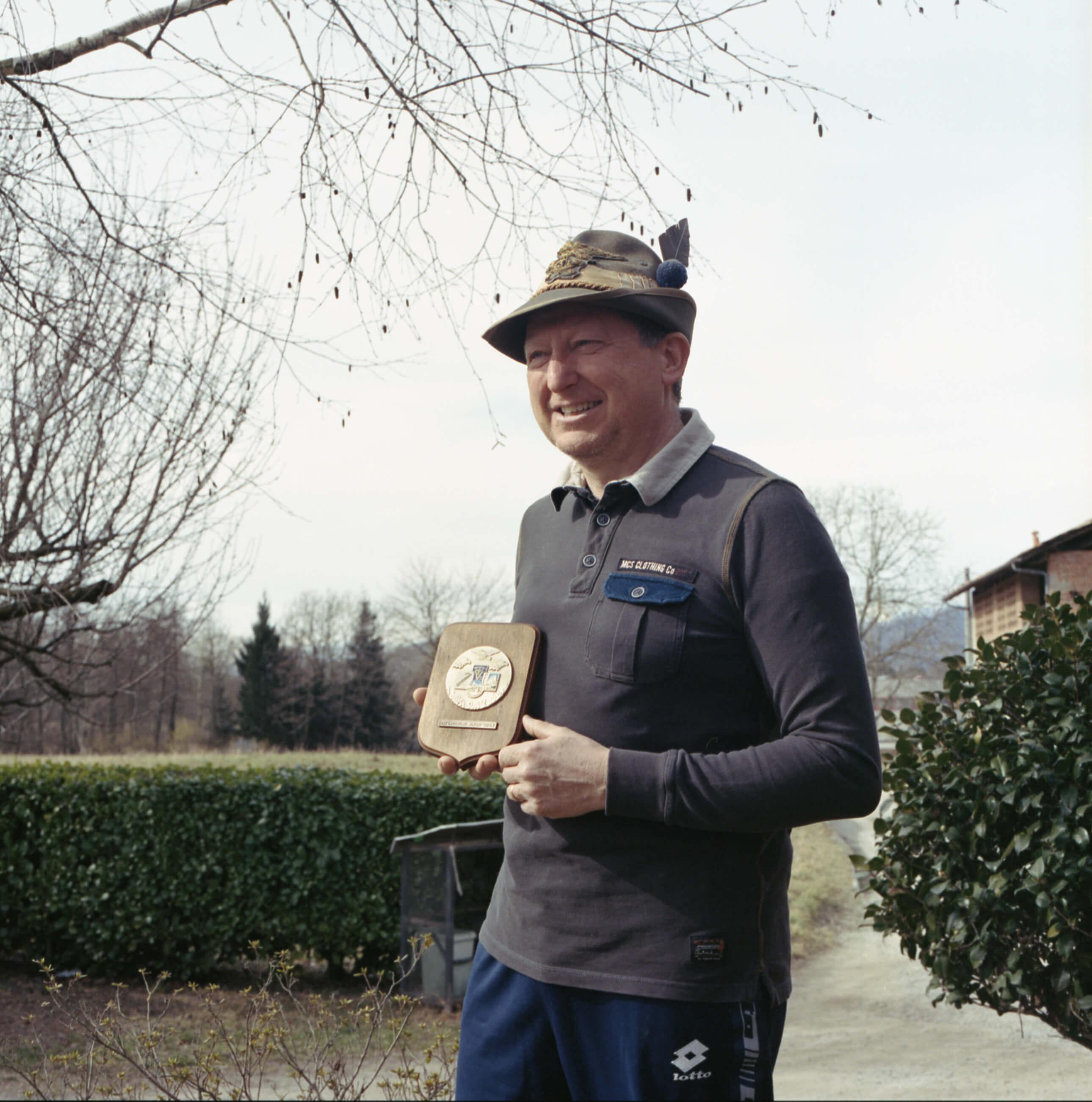 Giulia Simonotti SIAMO TUTTI ALPINI the south west collective of photography portrait of man holding a trophy